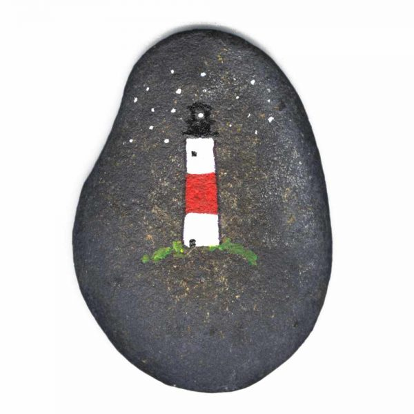 Beach Rock with a painted lighthouse at night