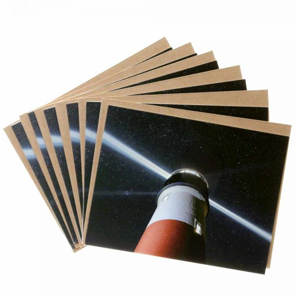 Note cards with the beacon of Sankaty Light house against the Milky Way