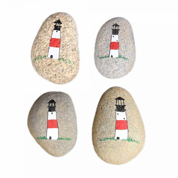 Four beach Rocks with a painted lighthouse